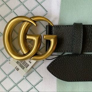 Woman's black leather Gold buckle Belt